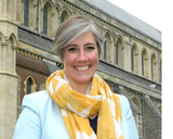 Daisy Cooper in front of St Albans Cathedral